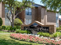 whispering oaks sign
